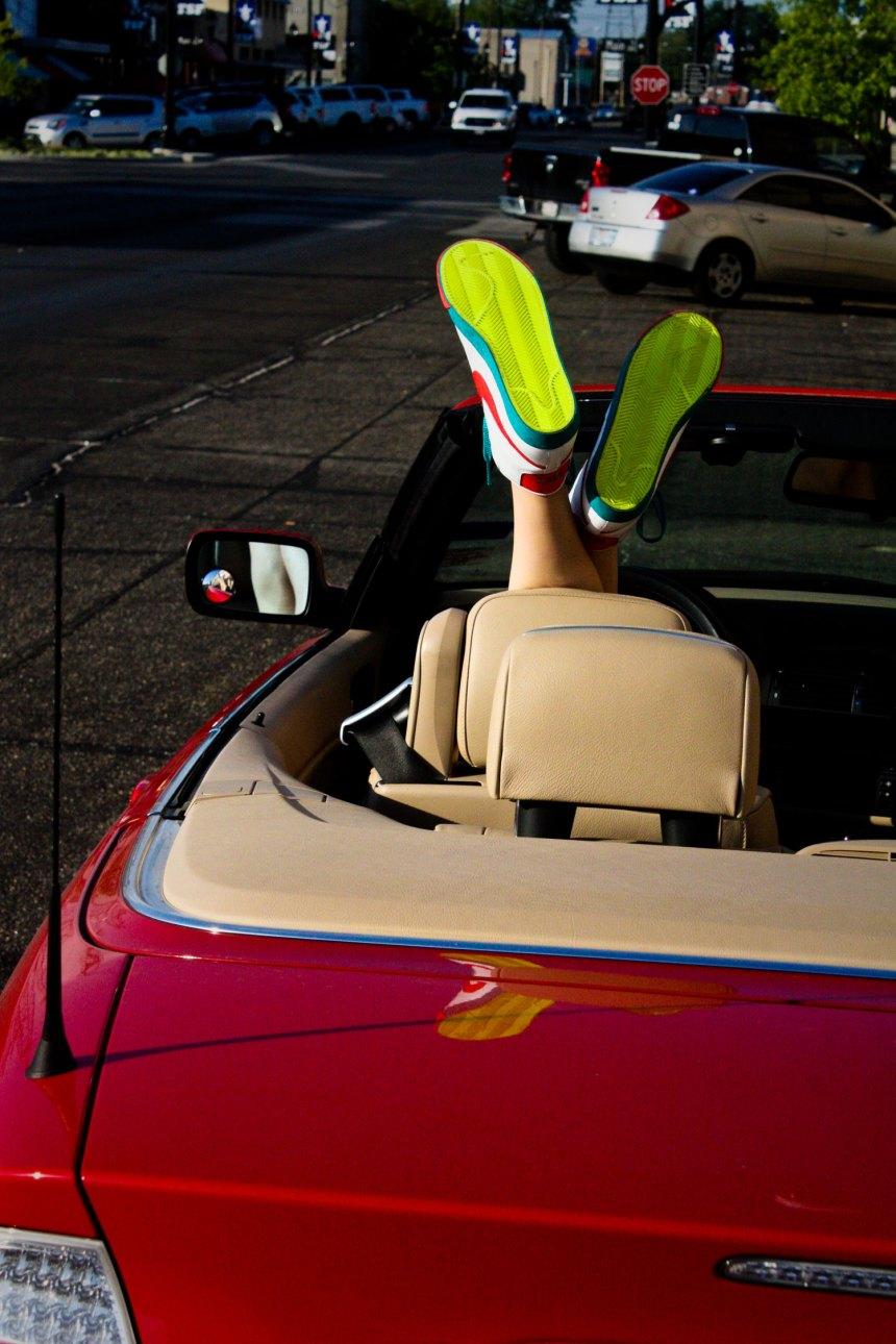 Nikes, convertible, downtown