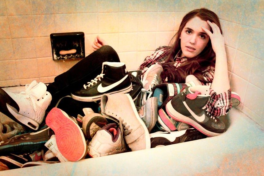 bathtub full of Nikes