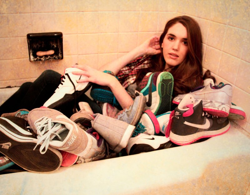 bathtub full of Nikes